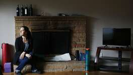 Lolly Mitchell of Redwood City sits for a portrait in her living room nearly empty of furniture on Wednesday, March 22, 2017 in Redwood City, Calif.   Mitchell is in the midst of moving to a new home in  Southern California.
