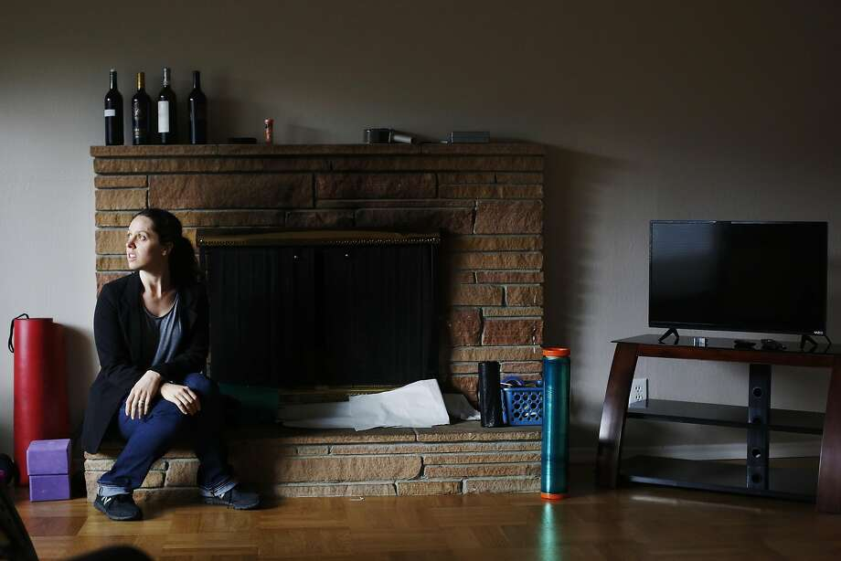 Lolly Mitchell of Redwood City sits for a portrait in her living room nearly empty of furniture on Wednesday, March 22, 2017 in Redwood City, Calif.   Mitchell is in the midst of moving to a new home in  Southern California. Photo: Lea Suzuki, The Chronicle