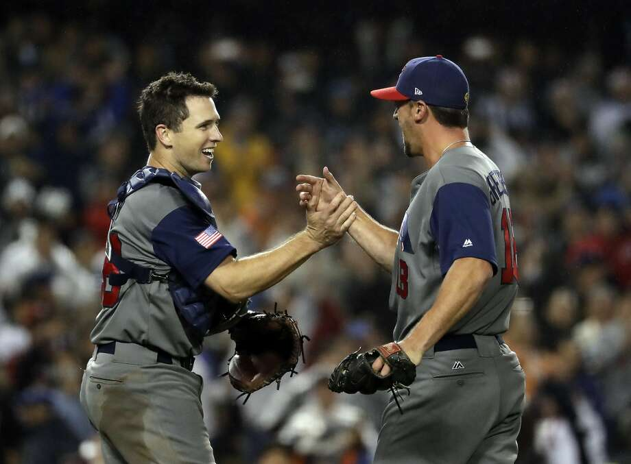 United States' Buster Posey and Luke Gregerson celebrate after the United States defeated Japan, 2-1, in a semifinal in the World Baseball Classic in Los Angeles, Tuesday, March 21, 2017. Photo: Chris Carlson, Associated Press