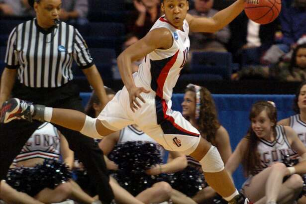 UCONN's Maya Moore takes the ball back to the UCONN side, during NCAA second round action against Texas in Bridgeport March 25, 2008.