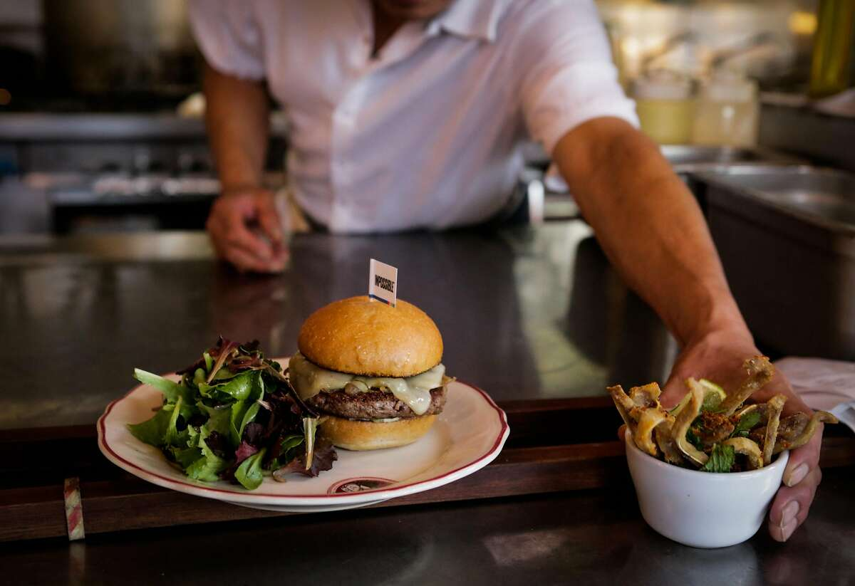 A plated Impossible burger is seen waiting to be served during lunch at Cockscomb restaurant in San Francisco, California, on Wednesday, March 22, 2017.