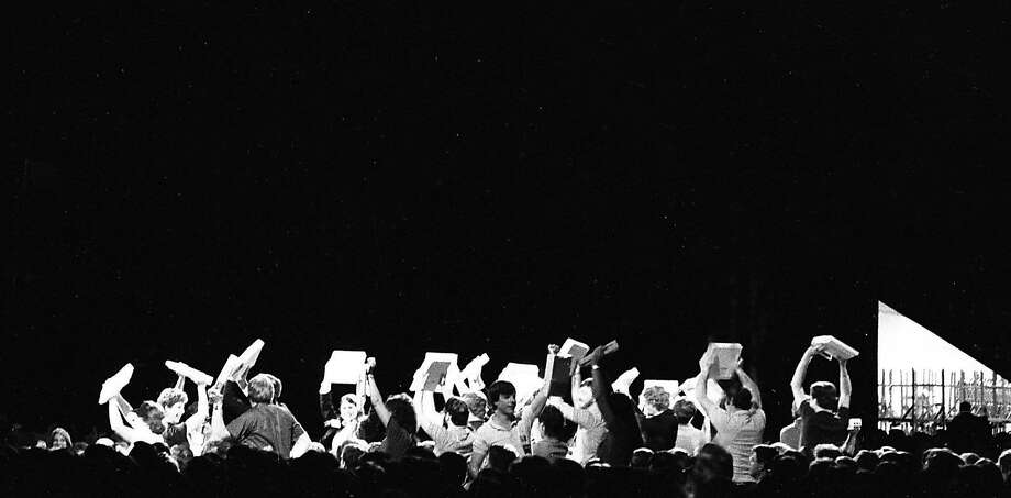 "Apple employees in the crowd lift up new Apple IIc computers at the ""Apple II Forever"" event on April 23, 1984. Photo: Gary Fong, The Chronicle"