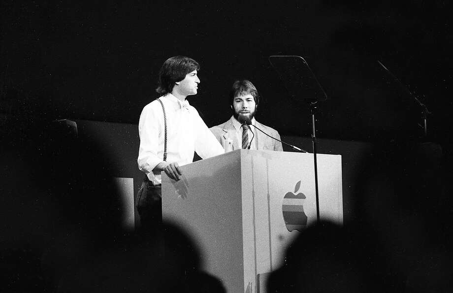 "Apple executives Steve Jobs and Steve Wozniak at a podium during the ""Apple II Forever"" event at Moscone Center in San Francisco on April 23, 1984. Photo: Gary Fong, The Chronicle"