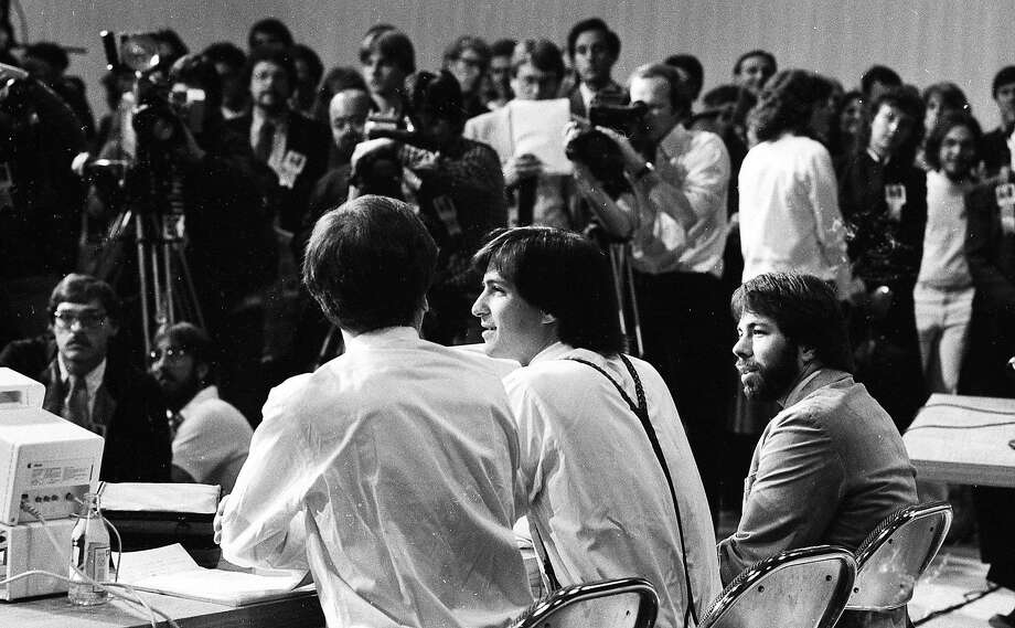"April 23, 1984: Apple executives John Sculley, Steve Jobs and Steve Wozniak introduce the Apple Iic at the ""Apple II Forever"" event at Moscone Center in San Francisco. Photo: Gary Fong, The Chronicle"