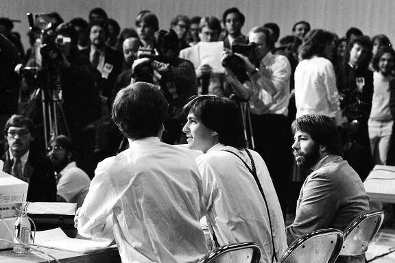 """April 23, 1984: Apple executives John Sculley, Steve Jobs and Steve Wozniak introduce the Apple Iic at the """"Apple II Forever"""" event at Moscone Center in San Francisco."""