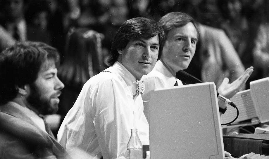 "April 23, 1984: Apple executives Steve Wozniak, Steve Jobs and John Sculley introduce the Apple Iic at the ""Apple II Forever"" event at Moscone Center in San Francisco. Photo: Gary Fong, The Chronicle"