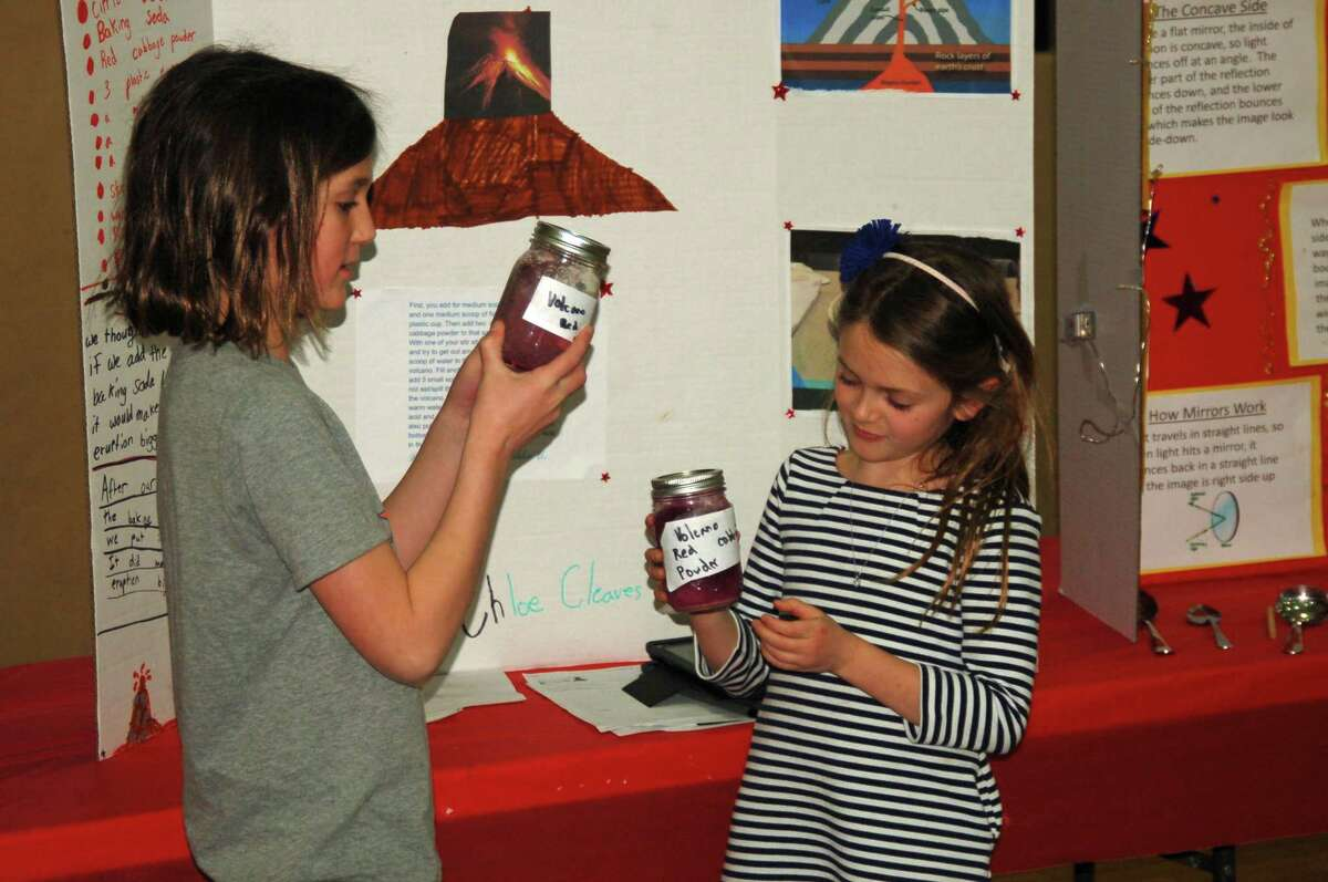 Chloe Cleaves, left, and Annalyn Pacifico, right, led a presentation on their volcano experiment for their third grade class at the recent Riverside School STEM fair.