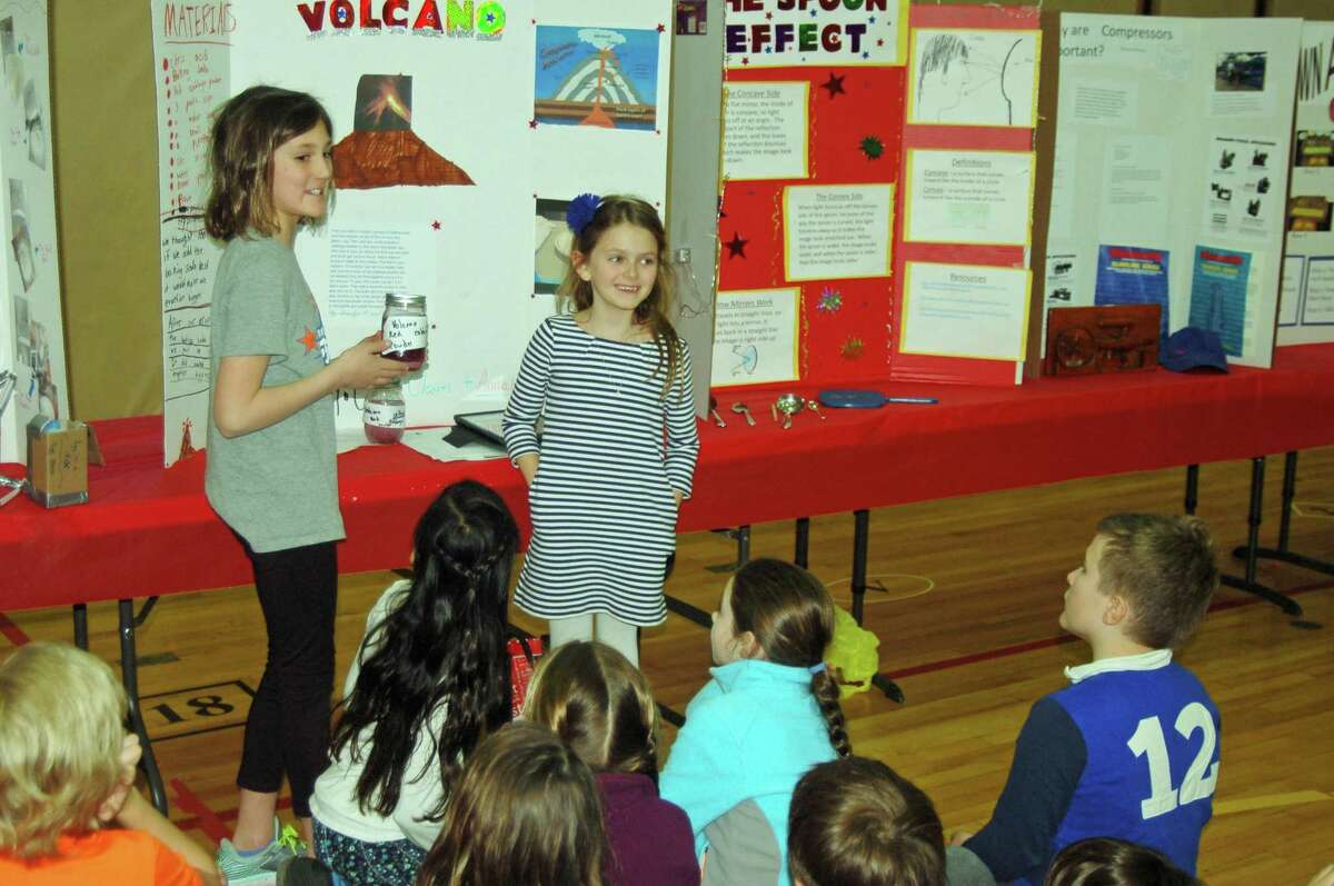 From left: Chloe Cleaves and Annalyn Pacifico lead a presentation on their volcano experiment for their third grade class at the recent Riverside School STEM fair.