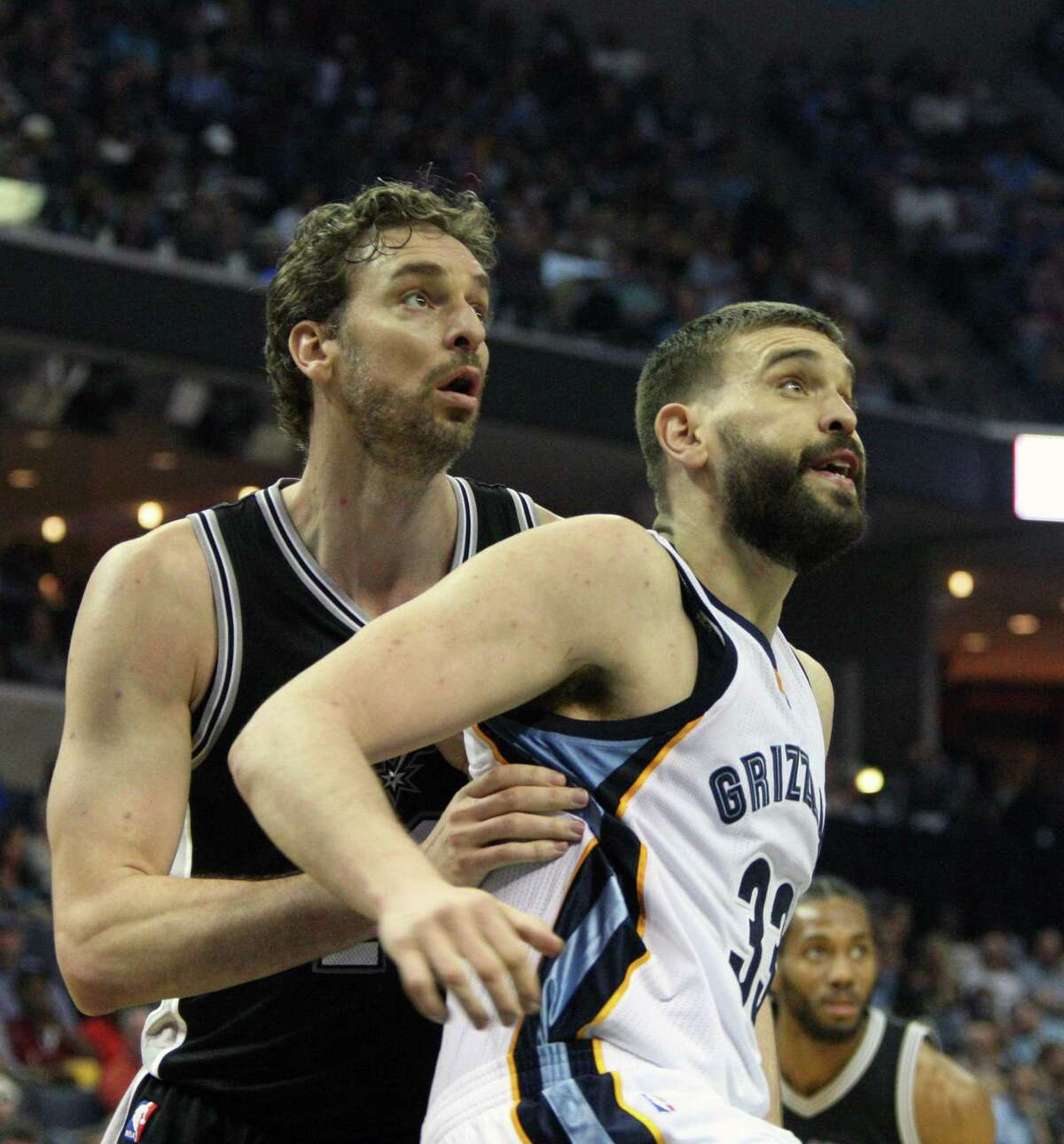 Spurs' Pau Gasol guards his brother, the Grizzlies' Marc Gasol in the first half on March 18, 2017 in Memphis, Tenn.