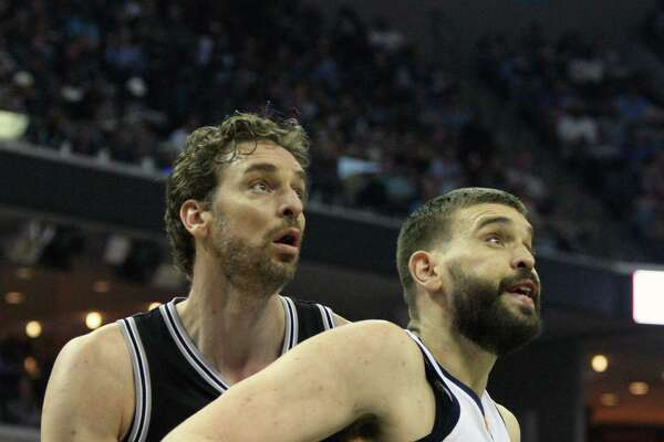 Spurs' Pau Gasol (left) guards his brother, the Grizzlies' Marc Gasol, in the first half on March 18, 2017, in Memphis, Tenn.