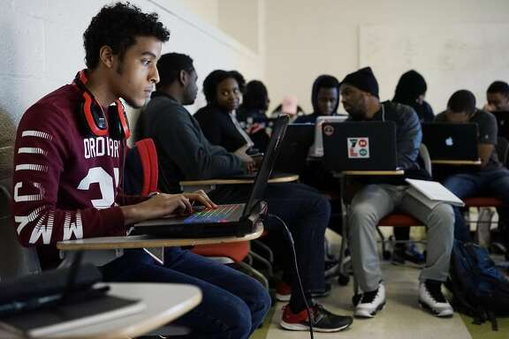 Howard University student Devin Armstrong works on an assignment during an advanced computer science on Wednesday March 22, 2017 in Washington D.C.  Google will be announcing a plan to find up-and-coming talent by reaching out to black computer science classes.