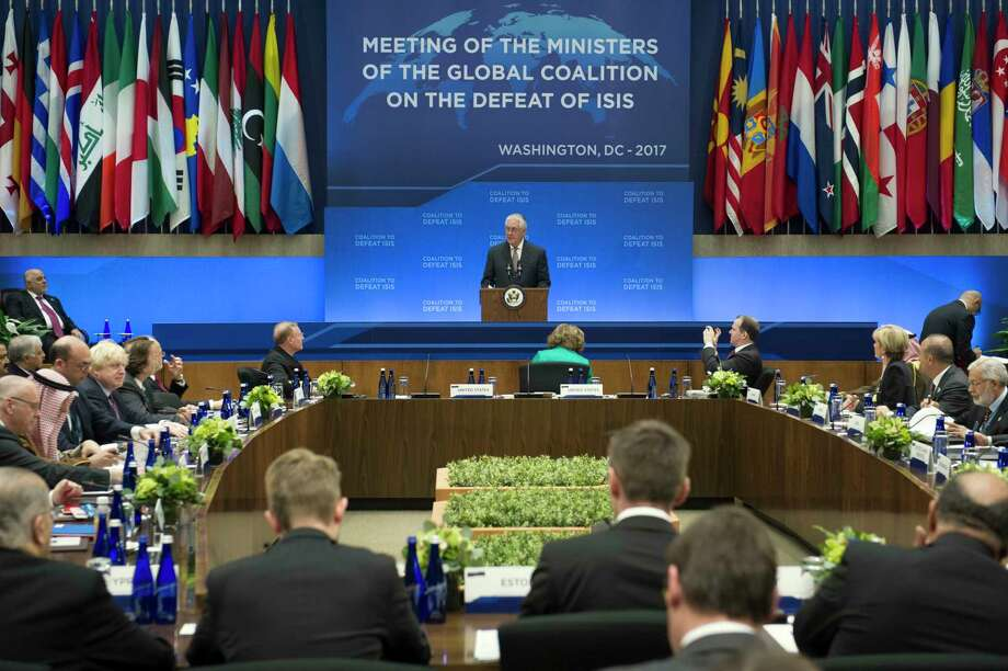 Secretary of State Rex Tillerson speaks at the Meeting of the Ministers of the Global Coalition on the Defeat of ISIS, Wednesday, March 22, 2017, at the State Department in Washington. Top officials from the 68-nation coalition fighting the Islamic State group are looking to increase pressure on the group as U.S.-backed forces move closer to retaking Mosul. (AP Photo/Cliff Owen) Photo: Cliff Owen, FRE / FR170079 AP