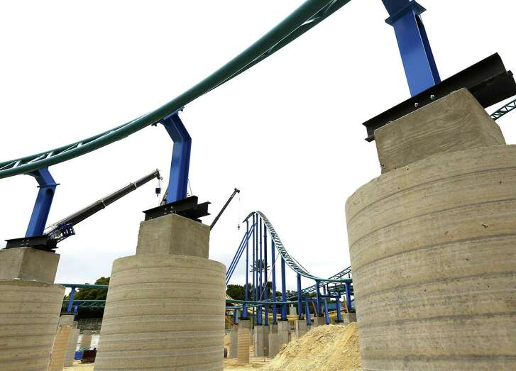 San Antonio tourism officials hope SeaWorld San Antonio's Wave Breaker roller coaster, seen under construction March 22, 2017, among other new attractions at San Antonio theme parks will drive tourism traffic this summer.