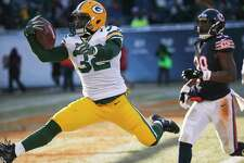 Green Bay Packers running back Christine Michael (32) celebrates as he runs to the end zone for a touchdown during the second half of an NFL football game against the Chicago Bears, Sunday, Dec. 18, 2016, in Chicago. (AP Photo/Charles Rex Arbogast)