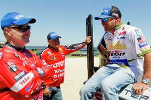 Anglers Jeff Kriet, right, jokes with Mark Menendez and Terry Schroggins at Lake Conroe on Tuesday.