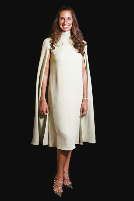 Lisa Holthouse wears Valentino.