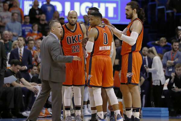 Oklahoma City Thunder head coach Billy Donovan coaches his team during a time out against the New Orleans Pelicans in the second half of an NBA basketball game in Oklahoma City, Sunday, Feb. 26, 2017. Oklahoma City won 118-110. (AP Photo/Alonzo Adams)