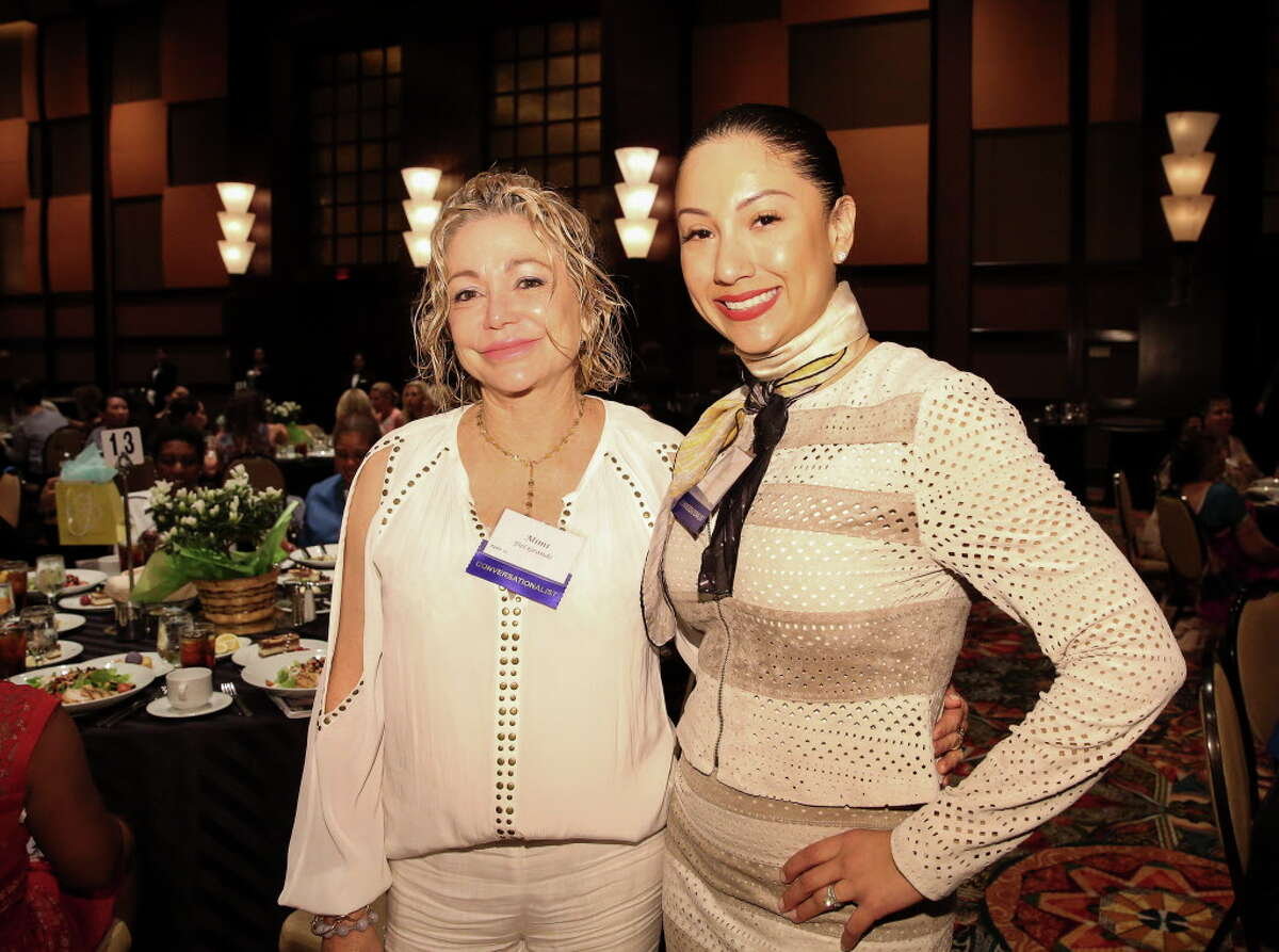 Mimi Del Grande, left, and Nancy Almodovar pose for a photo at the 20th Annual Table Talk luncheon at Hilton Americas Houston Wednesday, March 22, 2017, in Houston. The luncheon benefits the University of Houston Women's Studies Department.
