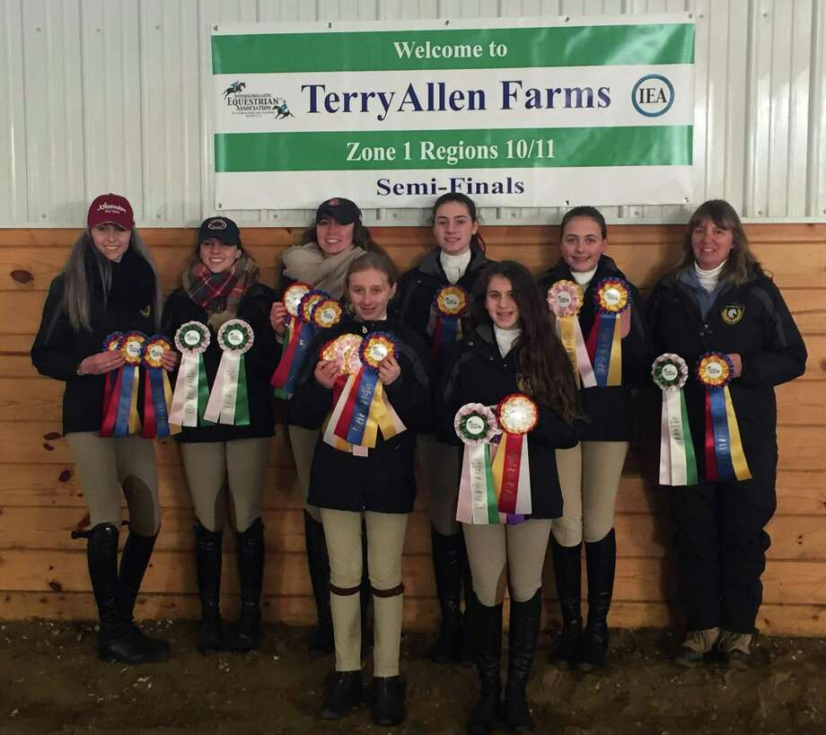 The Cavalier Farm High School IEA team was recently Champion at the IEA Zone 1 Region 10/11 Semi-Finals at Terry Allen Farm on March 4, 20176. The team and Individual riders will compete at Zone 1 Finals April 1-2 in Springfield, Mass. They are, from left to right, in front, Devon LeMoine and Madison Jennes, and in back, Alycia Petrauskas, Jordan Guilmart, Chelsea LeMoine, Annie Fouriner, Carolynn DeBellis and Cheryl LeMoine. Photo: Courtesy Of Cheryl LeMoine Photo / Contributed Photo / The News-Times Contributed