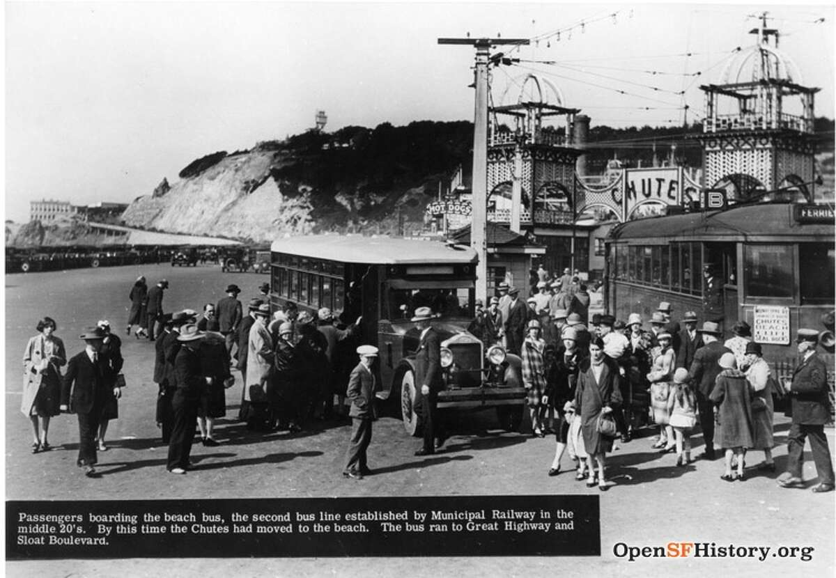 1920's: Playland at the Beach Mar 20, 1927. MUNI bus parked at foot of Cabrillo. View north. Left to right: Cliff House, Great Highway, Sutro Heights, Chutes entrance. SFMTA. Courtesy of OpenSFHistory.org.