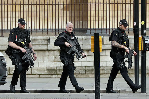 "Armed police officers enter the Houses of Parliament in London, Wednesday, March 23, 2017 after the House of Commons sitting was suspended as witnesses reported sounds like gunfire outside. The leader of Britain's House of Commons says a man has been shot by police at Parliament. David Liddington also said there were ""reports of further violent incidents in the vicinity.""(AP Photo/Kirsty Wigglesworth)"