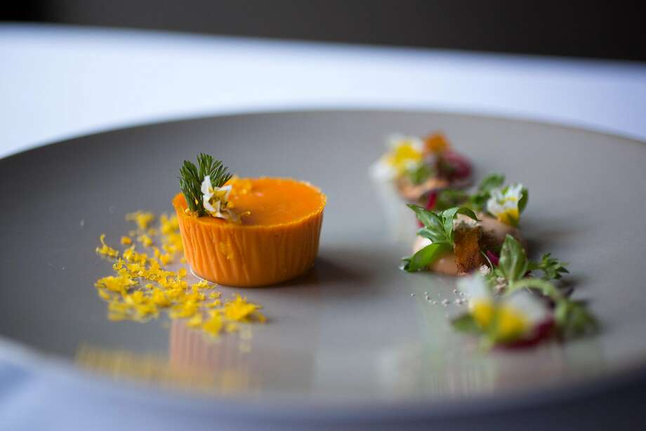 Acquerello: You won't find a better priced 2-Michelin star restaurant than this refined Italian restaurant where diners can order a three-course menu for $95.Pictured: Carrot budino, roasted chicken spuma, cured egg yolk, and chick weed dish at Acquerello in San Francisco Calif. Photo: Randi Lynn Beach, Special To The Chronicle