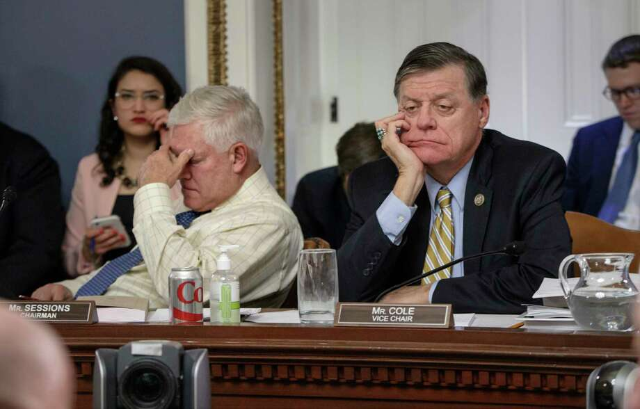After eight hours of debate, House Rules Committee Chairman Rep. Pete Sessions, R-Texas, left, and Rep. Tom Cole, R-Okla., the vice-chair, listen to arguments from committee chairs.  Photo: J. Scott Applewhite, STF / AP