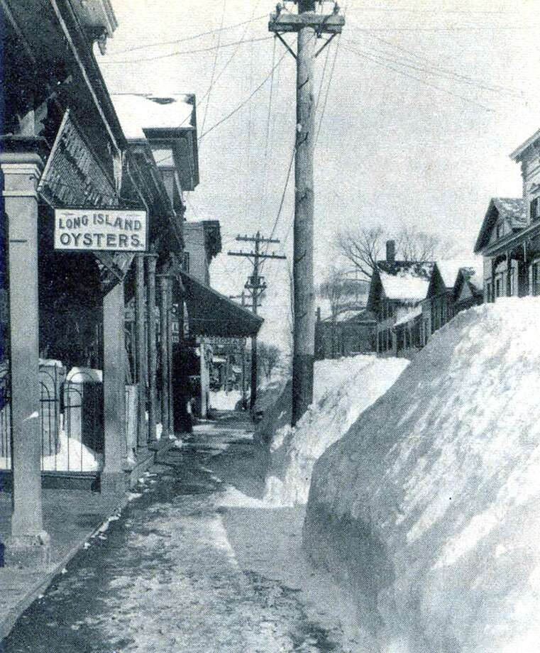 """This early 20th century photograph, taken from the collection of Frank L. Meloy, offers a glimpse of Bank Street looking east, from about where Bank Street Theater now is. Among the prominent shops then in business was one selling Long Island oysters. If you have a """"Way Back When"""" photograph you'd like to share, contact Deborah Rose at drose@newmilford.com or 860-355-7324. Photo: Contributed Photo / Contributed Photo / The News-Times Contributed"""