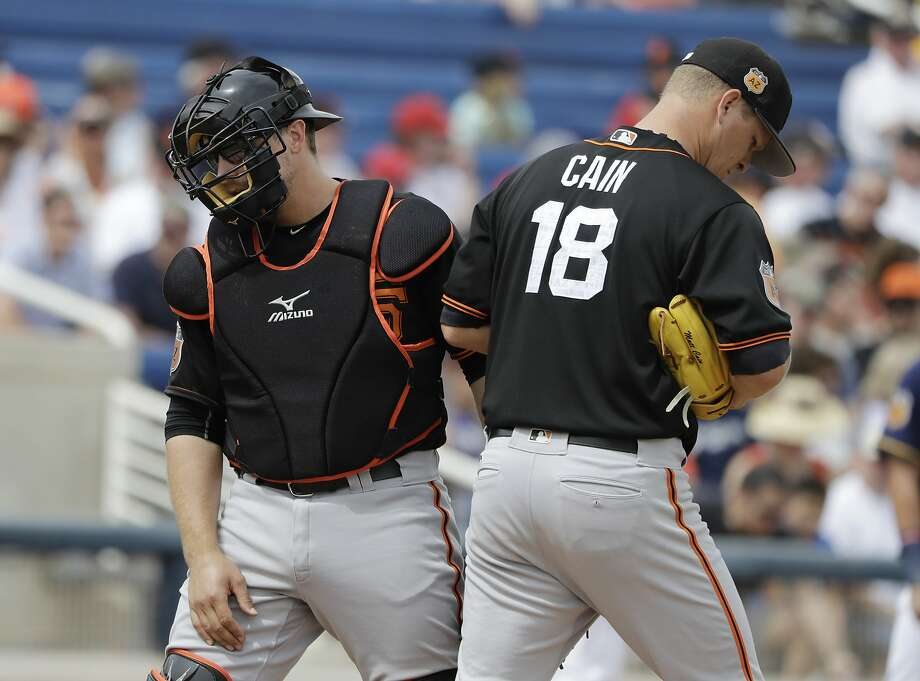 San Francisco Giants catcher Tim Federowicz walks back to the plate after talking with starting pitcher Matt Cain during the first inning of a spring training baseball game against the Milwaukee Brewers, Wednesday, March 22, 2017, in Phoenix. (AP Photo/Darron Cummings) Photo: Darron Cummings, Associated Press