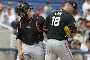 San Francisco Giants catcher Tim Federowicz walks back to the plate after talking with starting pitcher Matt Cain during the first inning of a spring training baseball game against the Milwaukee Brewers, Wednesday, March 22, 2017, in Phoenix. (AP Photo/Darron Cummings)