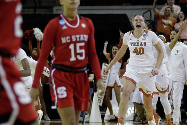 North Carolina State guard Lucky Rudd (15) walks off the the court as Texas center Kelsey Lang (40) and teammates celebrate an 84-80 win in a second-round game in the NCAA women's college basketball tournament, Sunday, March 19, 2017, in Austin, Texas. (AP Photo/Eric Gay)