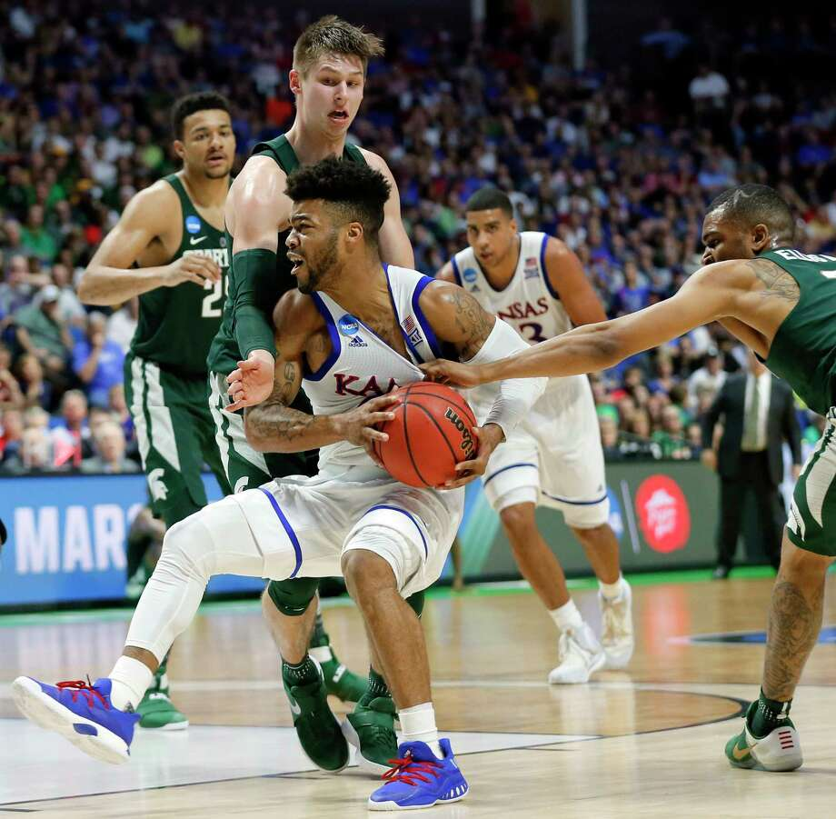 Michigan State' Matt McQuaid, left, and Alvin Ellis III, right, attempt to stop a drive to the basket by Kansas' Frank Mason III (0) in the second half of a second-round game in the men's NCAA college basketball tournament in Tulsa, Okla., Sunday, March 19, 2017. (AP Photo/Tony Gutierrez) Photo: Tony Gutierrez, STF / Copyright 2017 The Associated Press. All rights reserved.