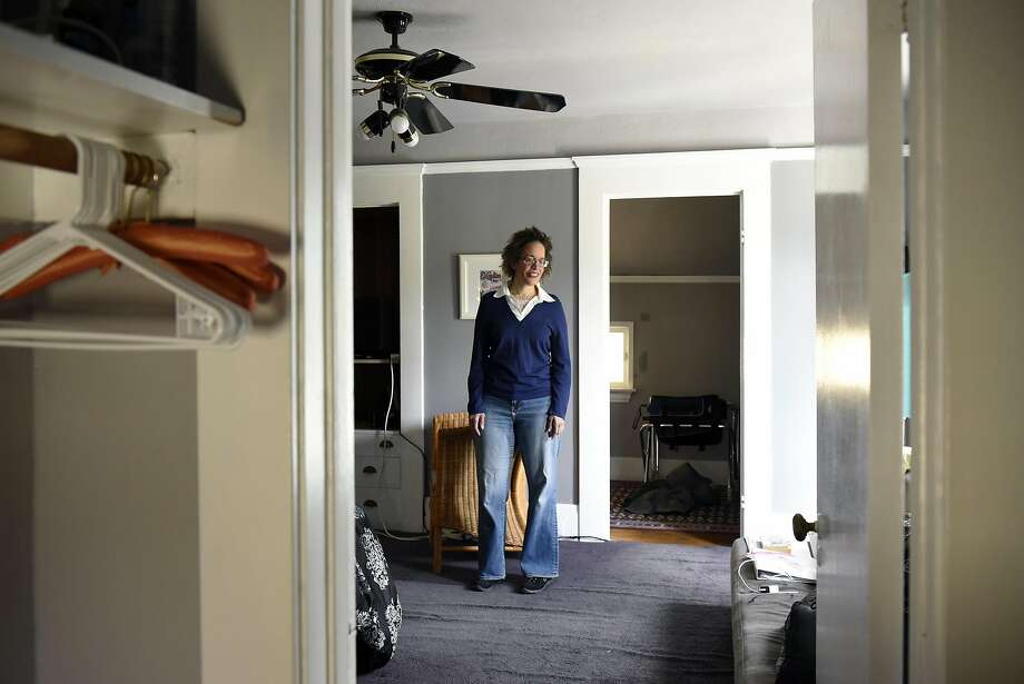 Oakland resident Cynthia Mackey stands in the bedroom that she rents   to guests through Airbnb. Photo: Michael Short, Special To The Chronicle