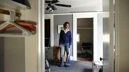 Cynthia Mackey stands in the bedroom that she rents out to guests through Airbnb, at her home in Oakland, CA, on Wednesday March 22, 2017.