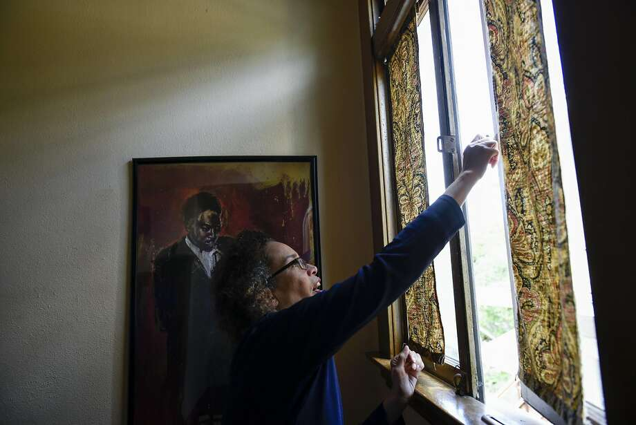 Airbnb host Cynthia Mackey opens a window at her home in Oakland, CA, on Wednesday March 22, 2017, where she rents out an extra bedroom. Photo: Michael Short, Special To The Chronicle
