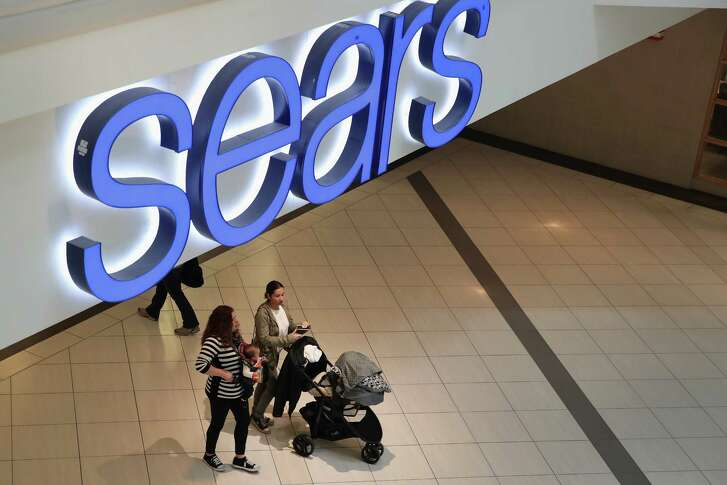 Shoppers visit a Sears store on Wednesday in the Chicago suburb of Schaumburg. For decades, Sears was king of the American shopping landscape.