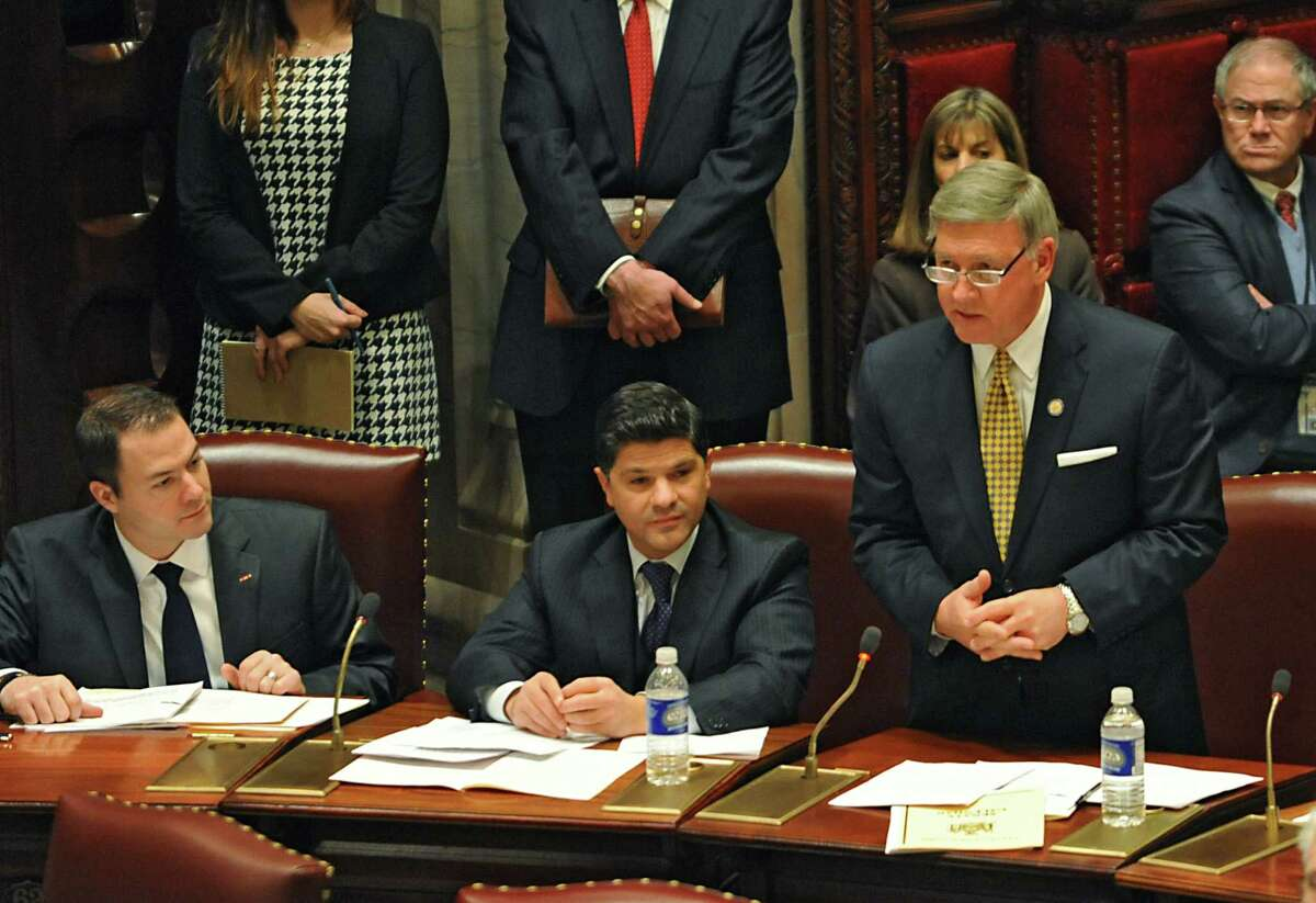 GOP Senator Rich Funke, right, talks about his vote on the Women's Equality Act bill at the NYS Capitol on Monday, Jan. 12, 2015 in Albany, N.Y. Senators George Amedore, center, and Robert Ortt (R ?- North Tonawanda), left, listen. (Lori Van Buren / Times Union)