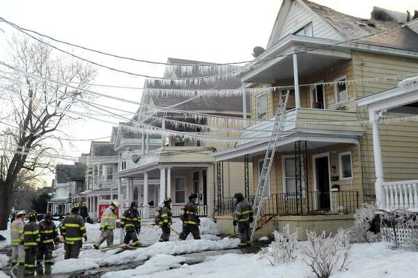 Firefighters battle a blaze at 2059 Park Ave. in Schenectady, N.Y. on March 22, 2017. (Robert Downen/Times Union)