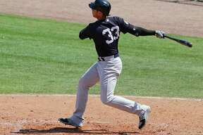New York Yankees' Greg Bird hits a 3-run home run in the sixth inning of a spring training baseball game against the Philadelphia Phillies, Wednesday, March 22, 2017, in Clearwater, Fla. (AP Photo/John Raoux) ORG XMIT: FLJR112