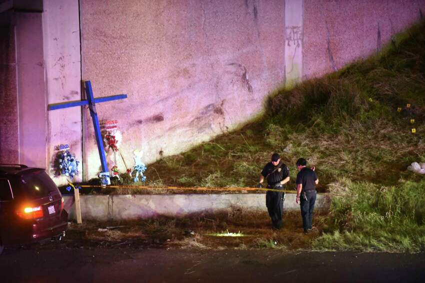 Police investigate the scene where a woman was attacked as she worked on a cross the edge of Highway 281 beneath the Hildebrand overpass on Wednesday night, March 22, 2017.