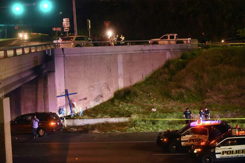 Police investigate the scene where a woman was attacked as she worked on a cross on the edge of Highway 281 beneath the Hildebrand overpass on Wednesday night, March 22, 2017.