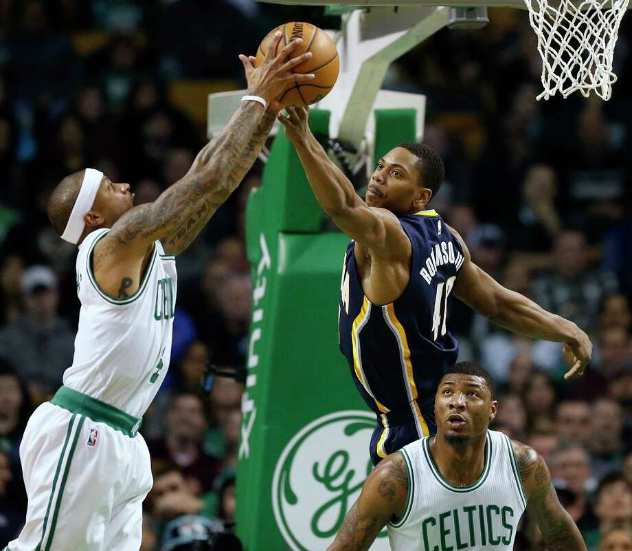 Indiana Pacers' Glenn Robinson III (40) and Boston Celtics' Isaiah Thomas, left, reach for a rebound during the second quarter of an NBA basketball game in Boston, Wednesday, March 22, 2017. (AP Photo/Michael Dwyer) ORG XMIT: MAMD104 Photo: Michael Dwyer / Copyright 2017 The Associated Press. All rights reserved.