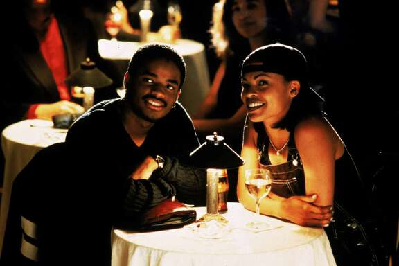 "Larenz Tate, left, and Nia Long starred in ""Love Jones"" in 1997. The movie, about two young black artists in love, came out during an era of films about the 'hood, like ""Menace II Society."" HOUCHRON CAPTION (06/14/1998): Larenz Tate and Nia Long star in the romantic comedy ""Love Jones.""  HOUCHRON CAPTION (11/21/2000): Larenz Tate, with Nia Long, right, plays a poet in Chicago who discovers how complicated love can be in Love Jones (1997), 7 tonight on UPN/Channel 20."