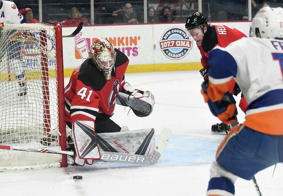 Albany Devils goalie Ken Appleby makes a save during a 5 on 3 advantage Bridgeport Sound Tigers power play at the Times Union Center on Wednesday, March 22, 2017 in Albany, N.Y. ( Lori Van Buren / Times Union) Photo: Lori Van Buren / 20039357A