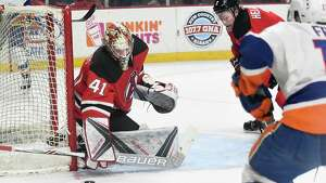 Albany Devils goalie Ken Appleby makes a save during a 5 on 3 advantage Bridgeport Sound Tigers power play at the Times Union Center on Wednesday, March 22, 2017 in Albany, N.Y. ( Lori Van Buren / Times Union)