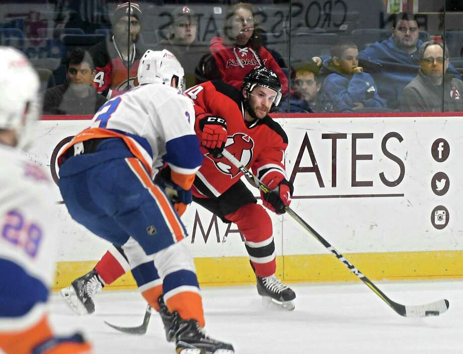 Albany Devils' Brian Gibbons passes the puck during a hockey game against the Bridgeport Sound Tigers at the Times Union Center on Wednesday, March 22, 2017 in Albany, N.Y. ( Lori Van Buren / Times Union) Photo: Lori Van Buren / 20039357A