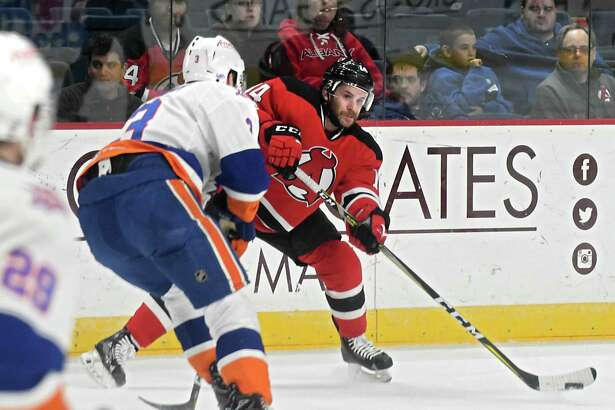 Albany Devils' Brian Gibbons passes the puck during a hockey game against the Bridgeport Sound Tigers at the Times Union Center on Wednesday, March 22, 2017 in Albany, N.Y. ( Lori Van Buren / Times Union)