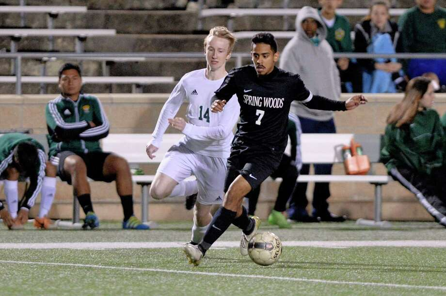 Sean Cooper (14) of Stratford chases Christian Hinojosa (7) of Spring Woods during the second half of a boys high school soccer game between the Stratford Spartans and the Spring Woods Tigers on Tuesday, March 7, 2017 at Tulley Stadium, Houston, TX. Photo: Craig Moseley, Staff / ©2017 Houston Chronicle