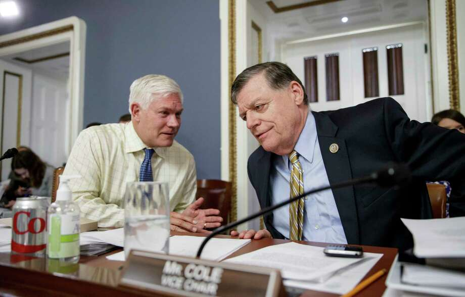 House Rules Committee Chairman Rep. Pete Sessions, R-Texas, left, and vice chair Rep. Tom Cole, R-Okla., confer as the panel meets to shape the final version of the Republican health care bill before it goes to the floor for debate and a vote, Wednesday, March 22, 2017, on Capitol Hill in Washington. (AP Photo/J. Scott Applewhite) ORG XMIT: DCSA140 Photo: J. Scott Applewhite / AP