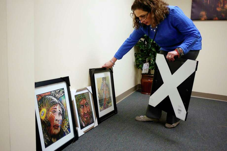 Micky Jimenez, regional director of the Capital district Camino Nuevo looks over the artwork of Wilfredo Rosado, a client of  on Camino Nuevo on Wednesday, March 22, 2017, in Albany, N.Y.  The artwork will be hung at the treatment center for a open house on Thursday, March 23rd.   (Paul Buckowski / Times Union) Photo: PAUL BUCKOWSKI / 20040027A